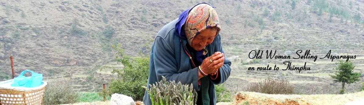 This woman was selling Asparagus on the road in Paro